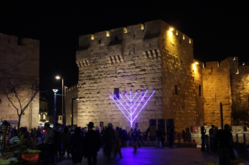 Hanukkiah in front of the Old City walls in Jerusalem. [Photo: Wikimedia Commons]