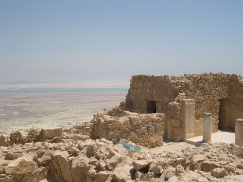 Ruins overlooking the Dead Sea. Homes like this could be afflicted with tzaraat during Biblical times. [Photo: Wiki Commons]